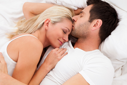 Man and lady lying bed together