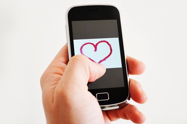Mobile phone with a heart on the screen