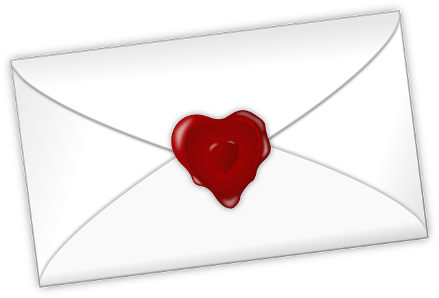 An envelope with a heart shaped seal