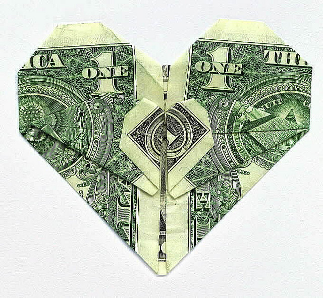 Money folded into a heart shape