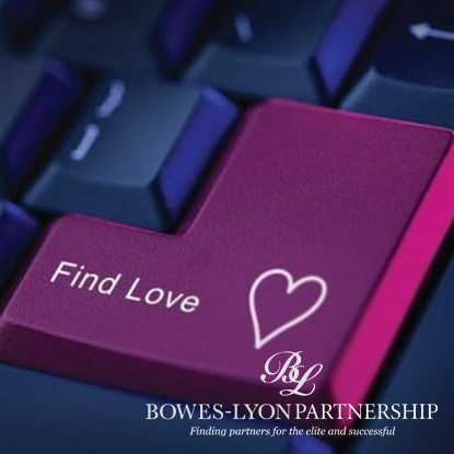 """Computer keyboard with """"find love"""" written on the enter key"""