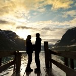 A couple standing on a jetty