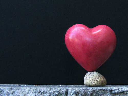 A heart balancing on a rock