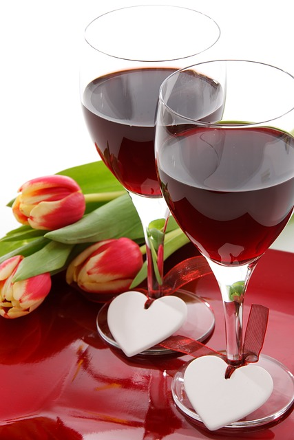 Two wine glasses and a bunch of flowers