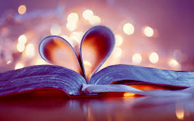 An open book with pages creating a heart shape
