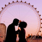 Silhouette of a couple in front of the London Eye