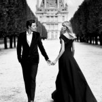 well-dressed couple holing hands