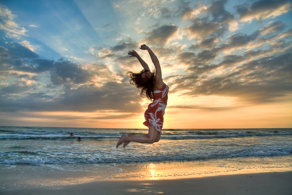 Lady jumping on the beach