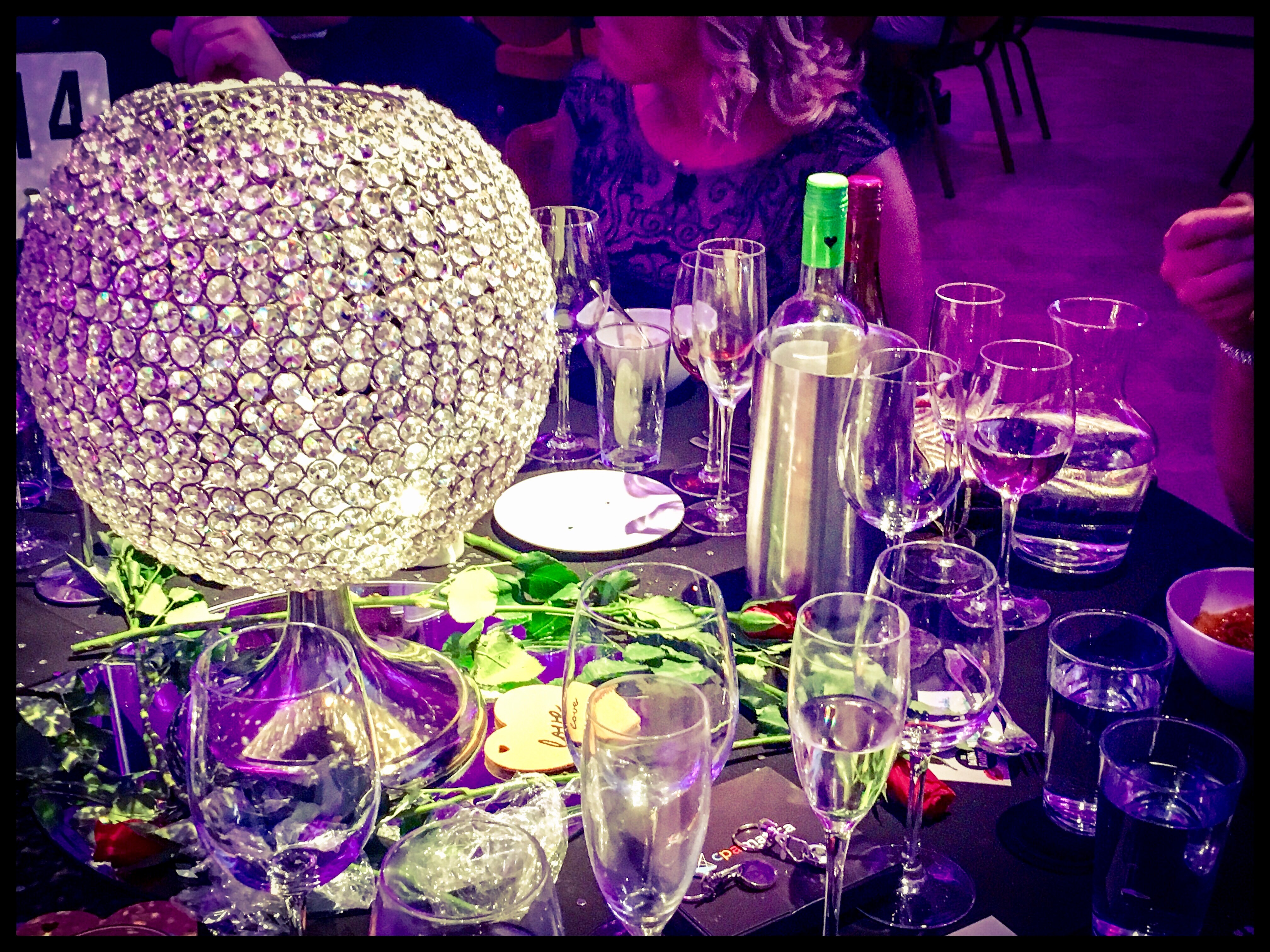Glitter ball and hearts and flowers on the table
